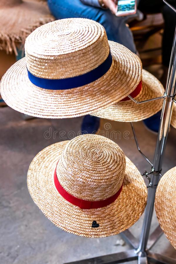 Straw hats shop. Straw hats on a spring festival market. stock photos