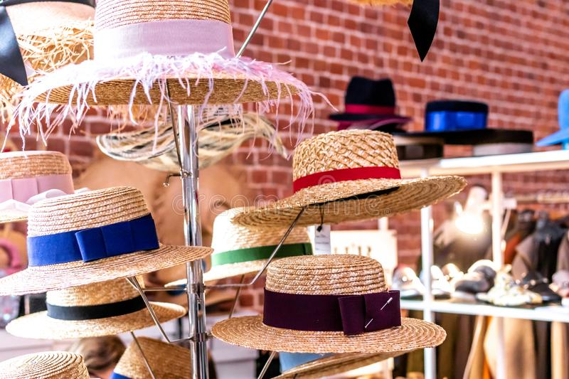 Straw hats shop. Straw hats on a spring festival market. royalty free stock images