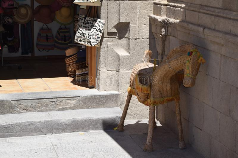 Straw horse at the door of the gift shop. Decorative horse of straw near the store. Spanish village. Barcelona. May 2017 royalty free stock photo
