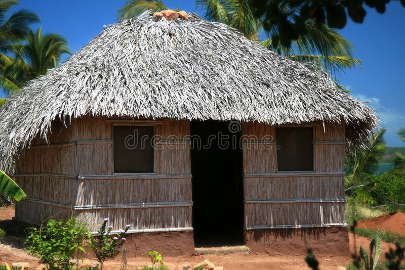 Straw Hut near the ocean stock images