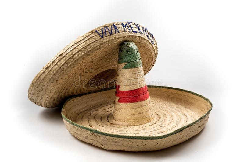 The straw Mexican sombreros hat on white background isolated royalty free stock photo