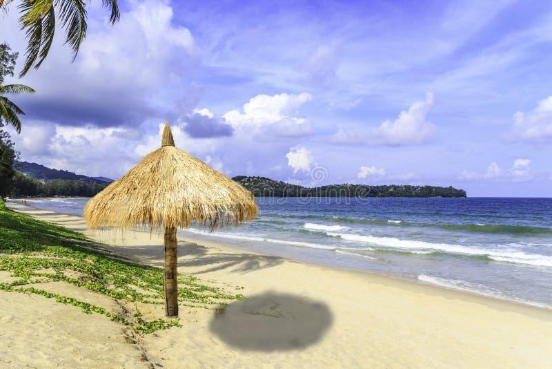 Straw parasol on Bang Tao beach. On a sunny day, Phuket, Thailand royalty free stock photos