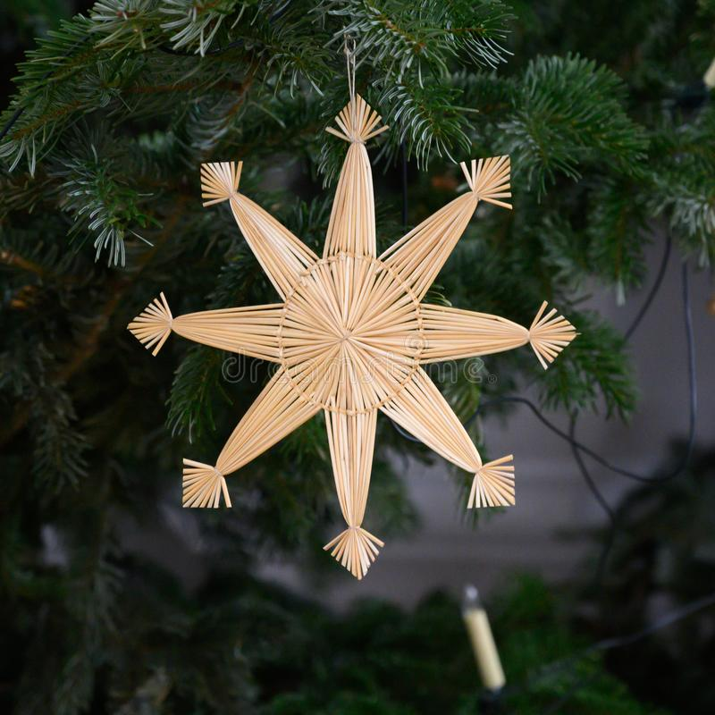Straw Star - Christmas Straw Star on Christmas Tree, traditional Christmas Tree Decoration stock images