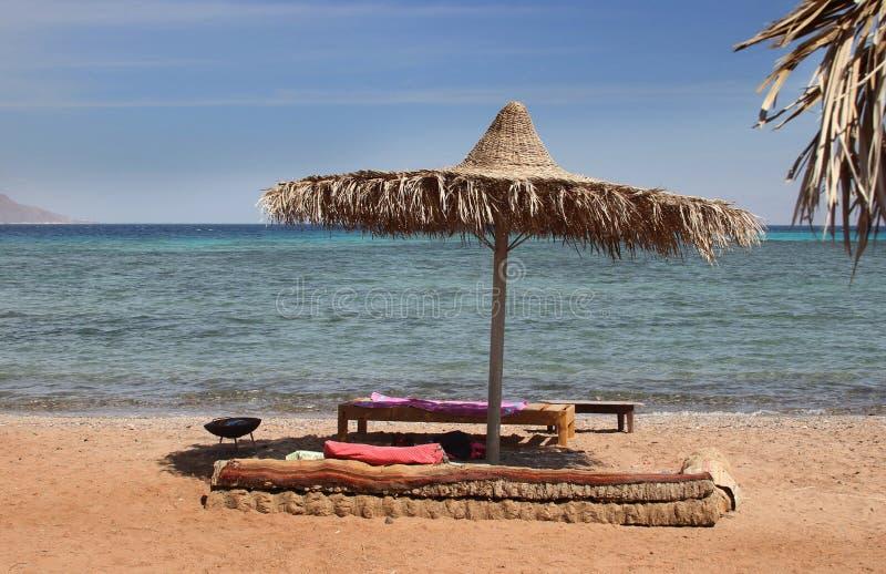 Straw umbrella on the beach, Egypt, Nuweiba stock photography