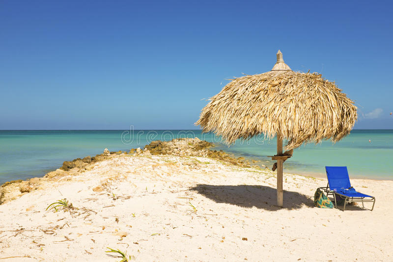 Download Straw Umbrella On A Tropical Beach Stock Image - Image: 38669287