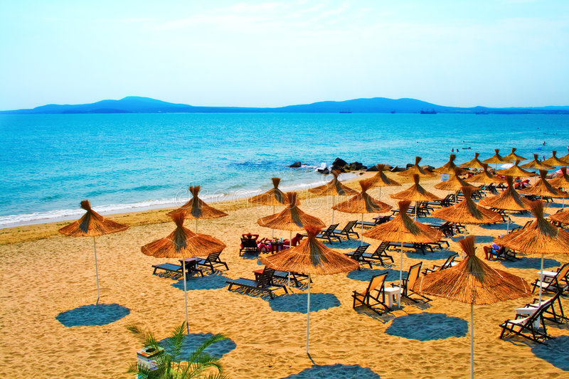 Straw umbrellas on peaceful beach in Bulgaria royalty free stock photo