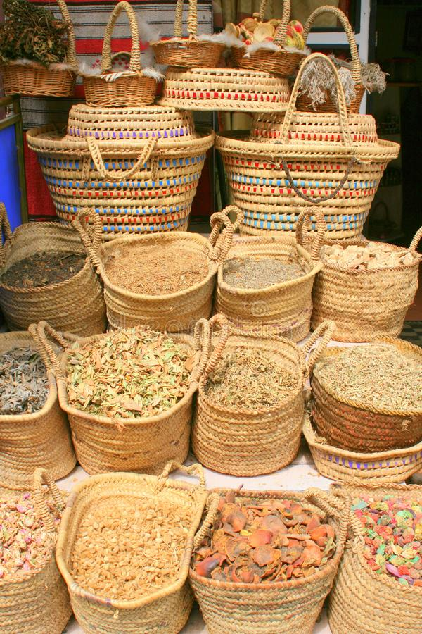 Straw woven baskets of herbs and spices stock photos
