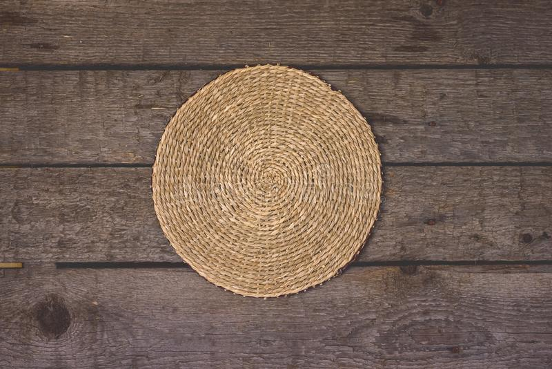 Straw Woven Round Hand Made Texture on Old Wooden Packground with Clipping Path Horizontal stock photography