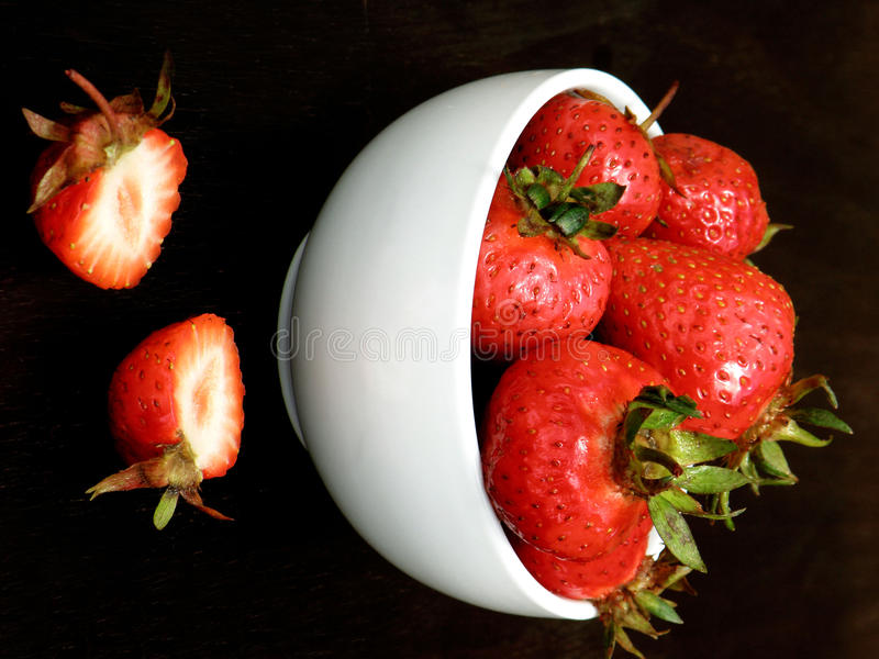 Strawberies in a bowl royalty free stock photo