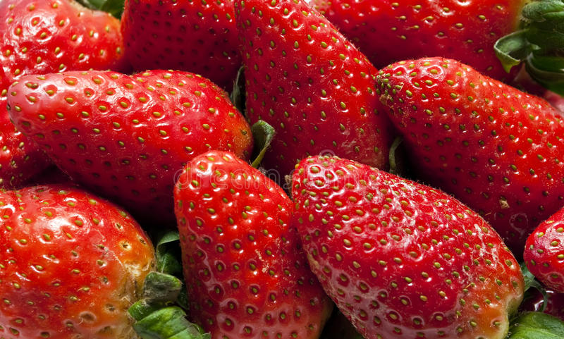 Strawberries. Set of red strawberries grouped stock photo