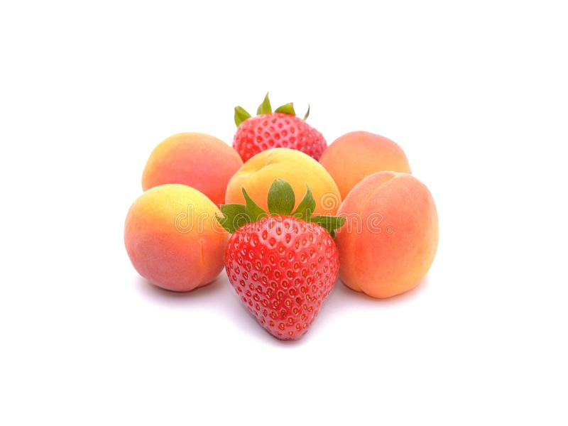 Strawberries and apricots stock photos