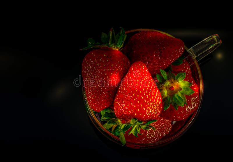 Strawberries and bananas are on the table. Dessert royalty free stock photography