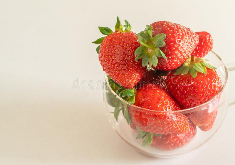 Strawberries and bananas are on the table. Fruit dessert stock photography