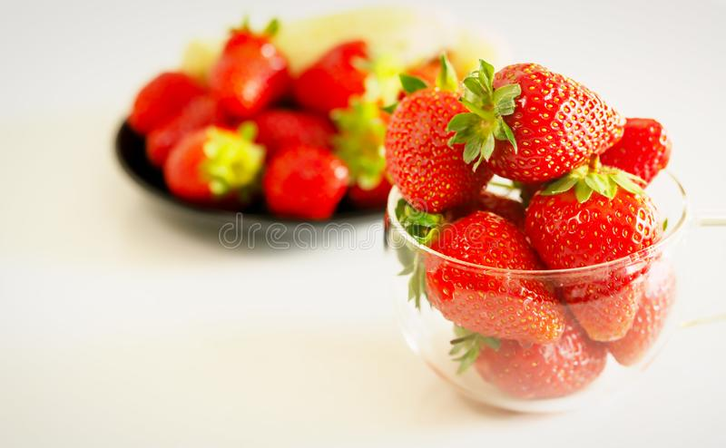 Strawberries and bananas are on the table. Fruit dessert royalty free stock image