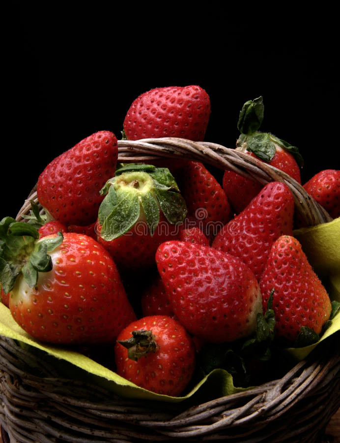 Strawberries basket. A basket of delicious riped strawberries royalty free stock photos