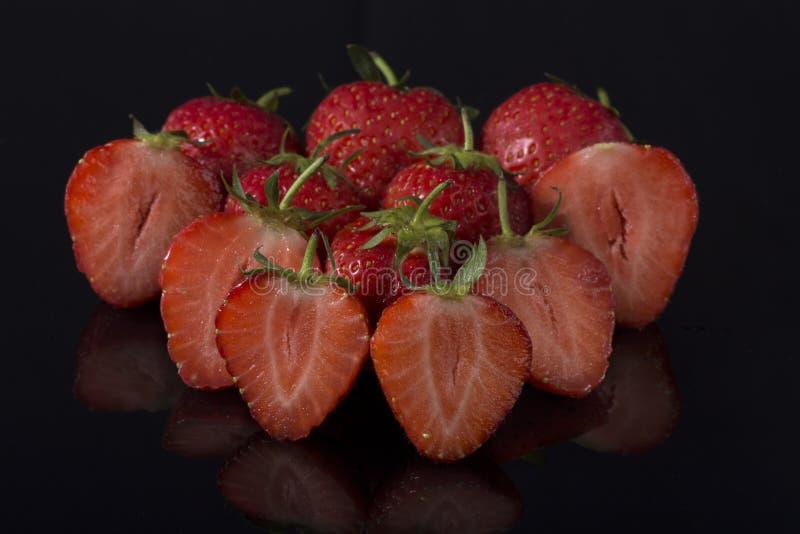 Strawberries on black acrylic royalty free stock photos