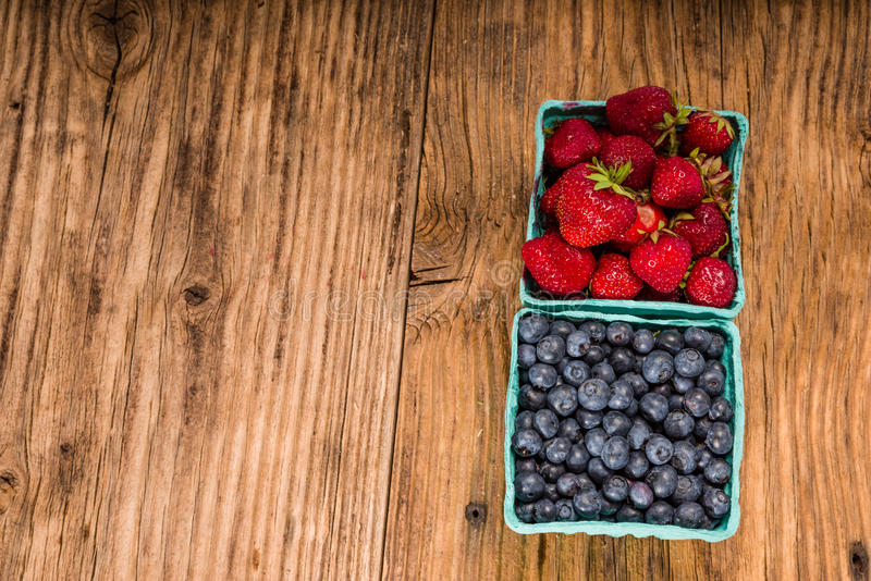 Strawberries and blueberries royalty free stock images