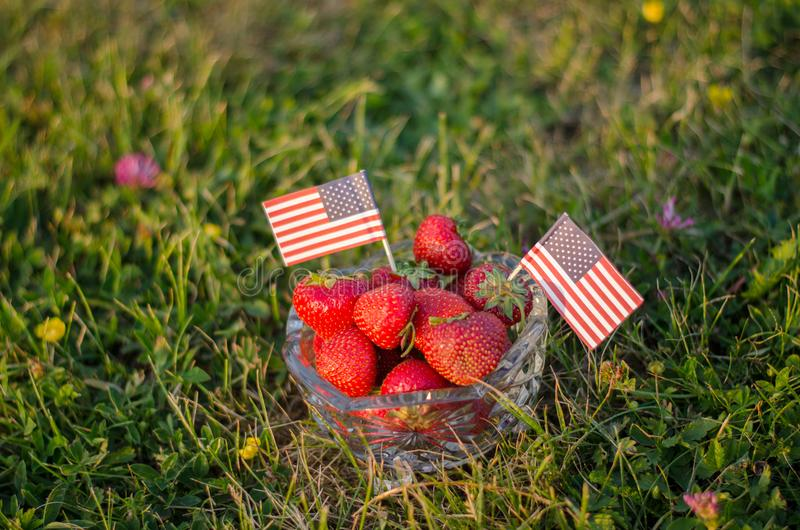 Strawberries in a bowl with american flags stock photo