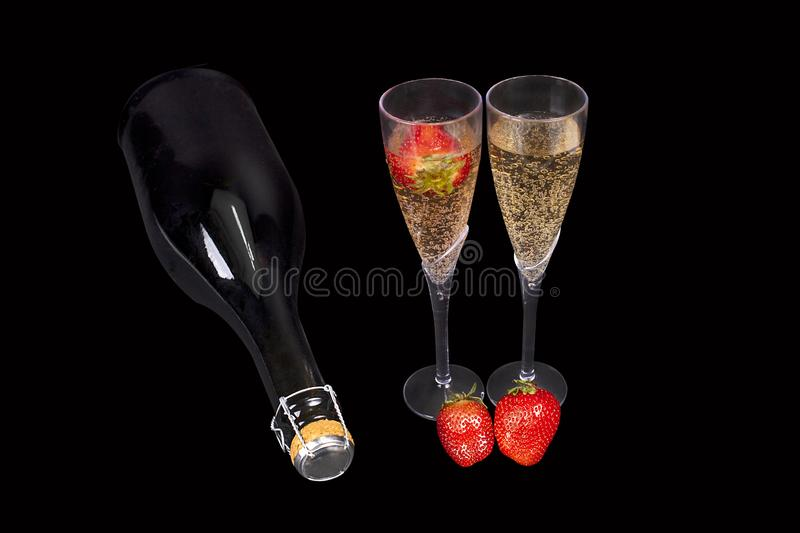 Strawberries & Champagne In Flutes With Bottle, On Black stock image