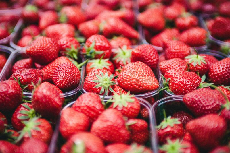 Strawberries on Clear Plastic Containers stock photos