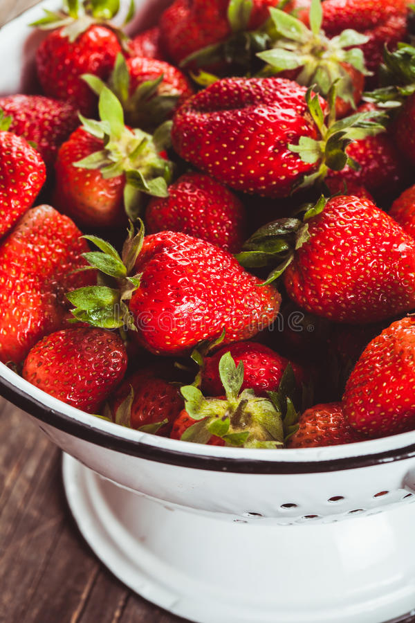 Strawberries in colander royalty free stock images