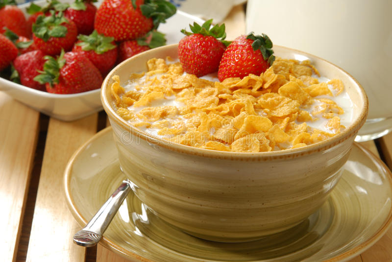 Strawberries and corn flakes stock photos