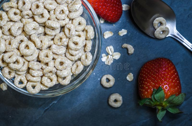 Breakfast made up of dry cereal with red strawberries royalty free stock photos