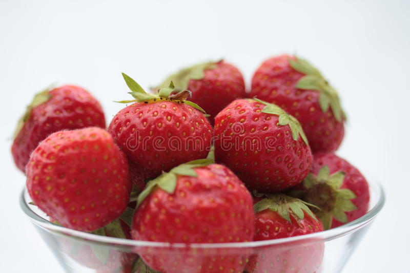 Strawberries in glass stock image