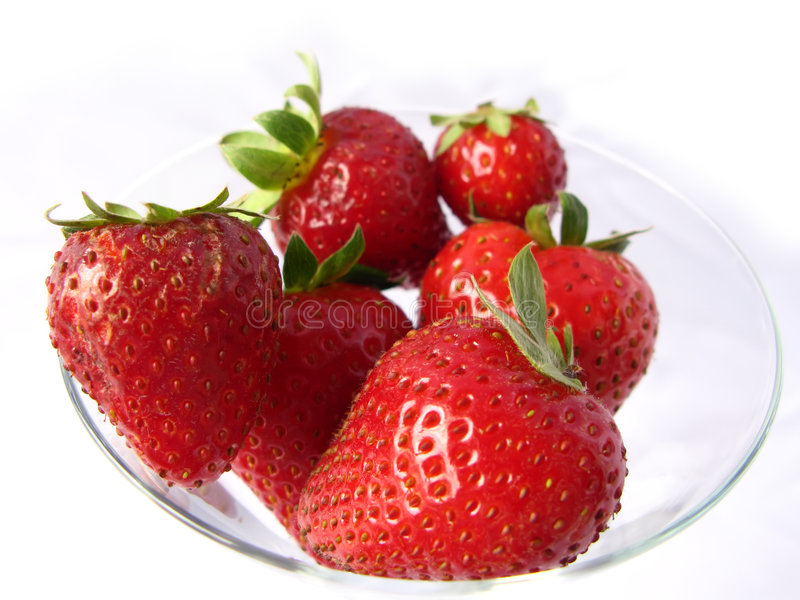 Strawberries in a glass bowl royalty free stock photo