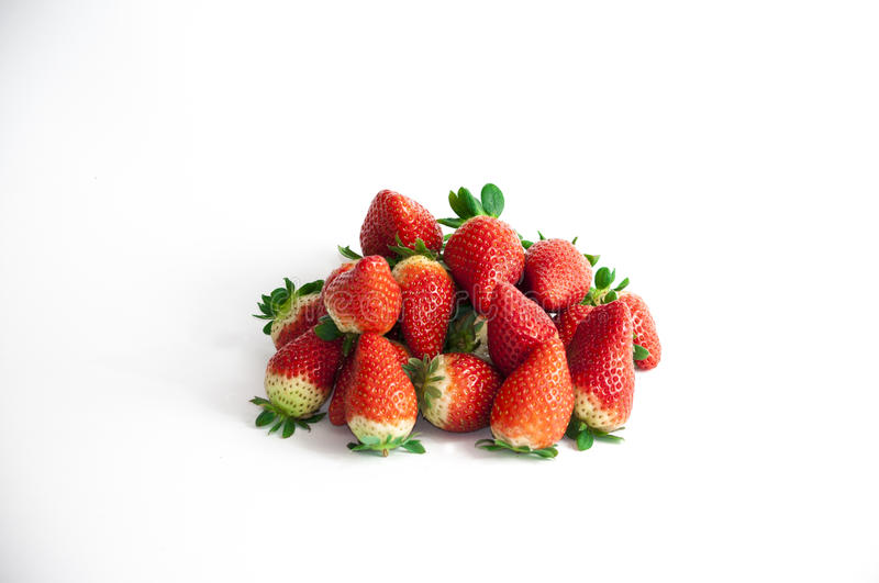 Strawberries grouped. Stil life of organic strawberries grouped stock images
