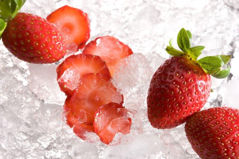 Strawberries on ice stock photos
