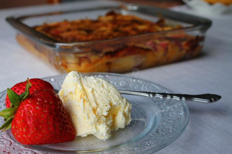 Strawberries ice cream and cake - selective focus royalty free stock photography