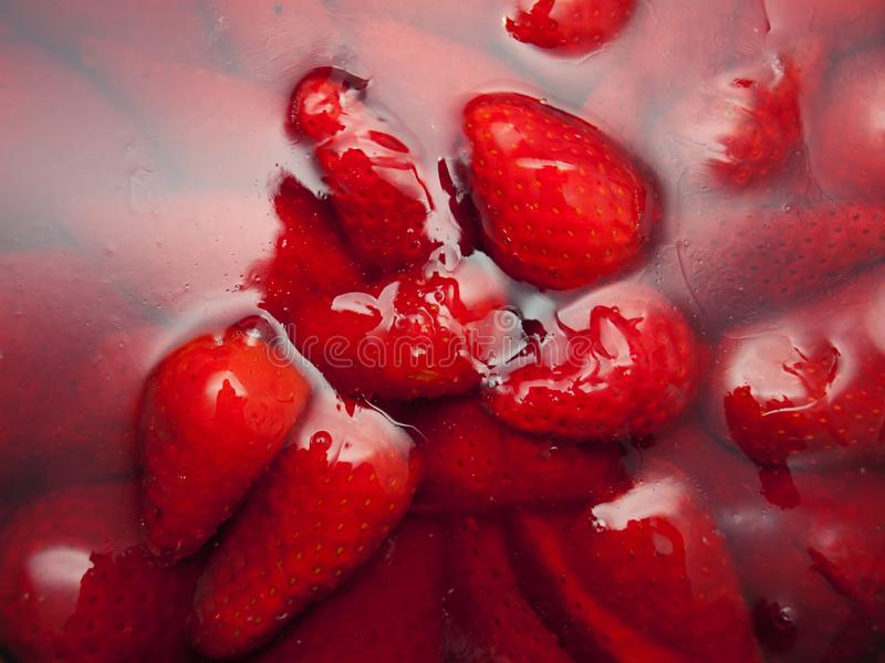 Strawberries in jelly stock photo