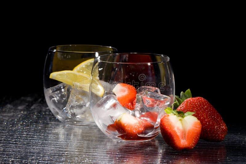 Strawberries and lemon on ice - Cocktail Dessert stock image