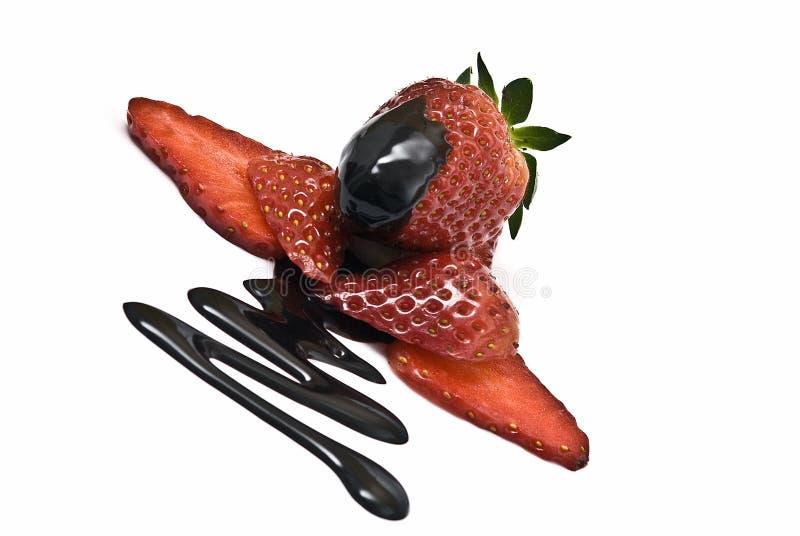 Strawberries with liquid chocolate. stock photos