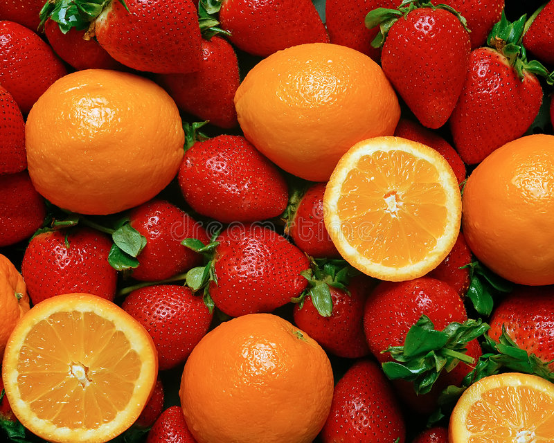 Strawberries and Oranges royalty free stock image