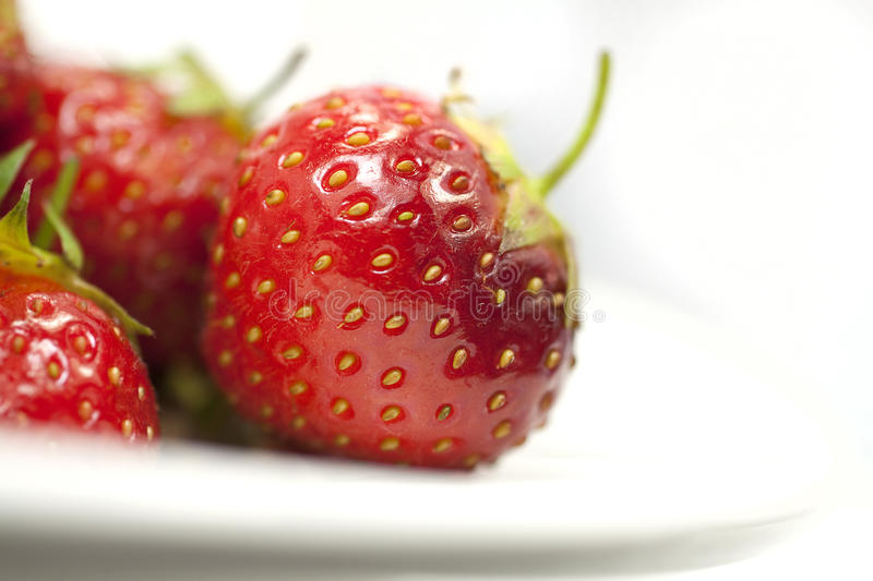 Strawberries on a plate_closeup royalty free stock image