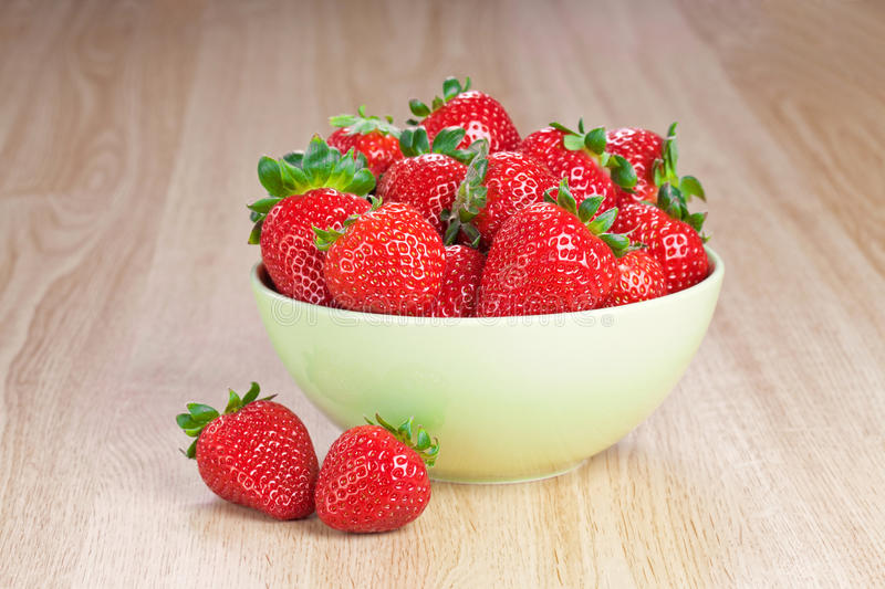 Download Strawberries In A Plate On The Wooden Table Stock Photo - Image: 24119978