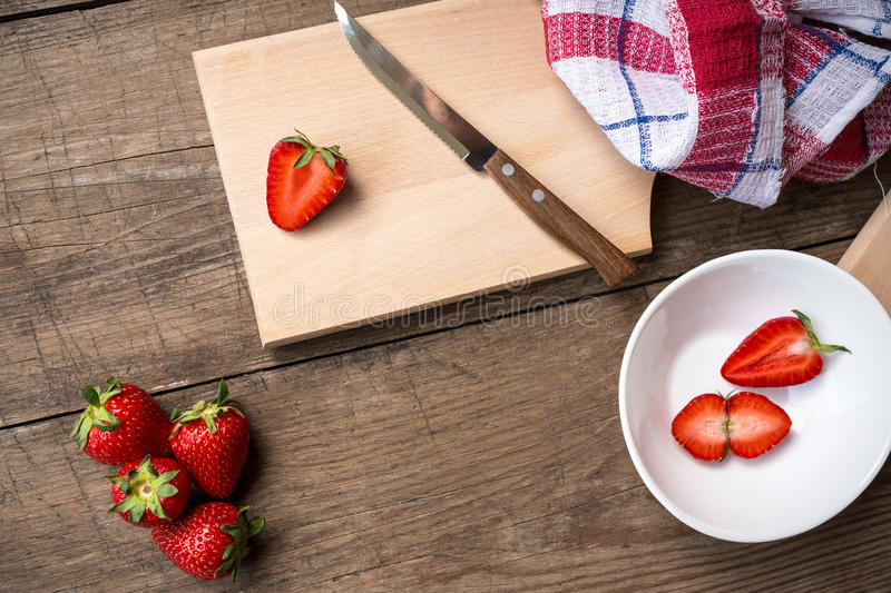 Strawberries sliced on chopping board. Fresh strawberries sliced on chopping board stock image