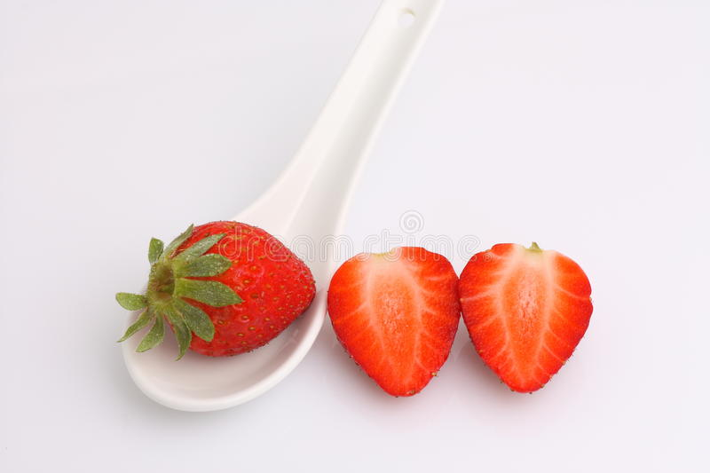 Strawberries and spoon. Photography of Study of strawberries and spoon on white bottom royalty free stock photos