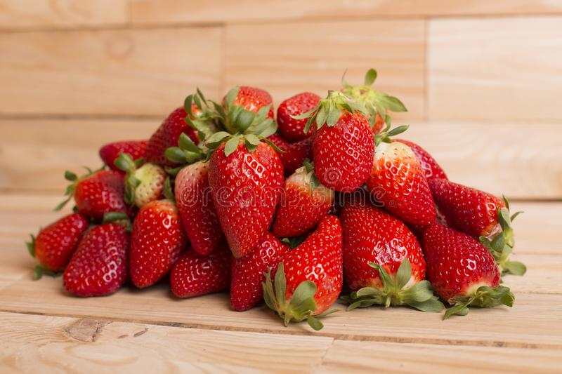 Strawberries. On a wooden table, studio picture stock image