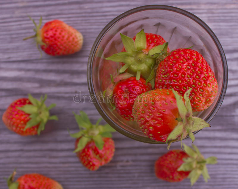 Strawberries on the table stock image