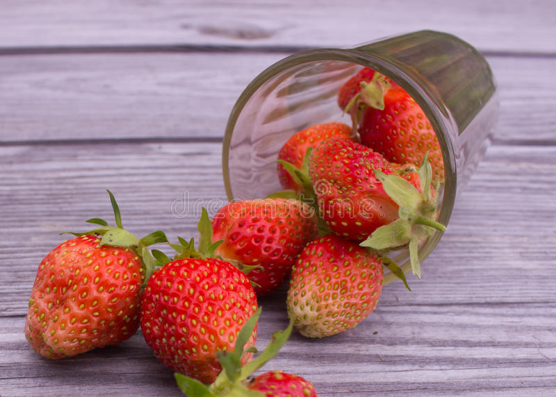 Strawberries on the table stock photos
