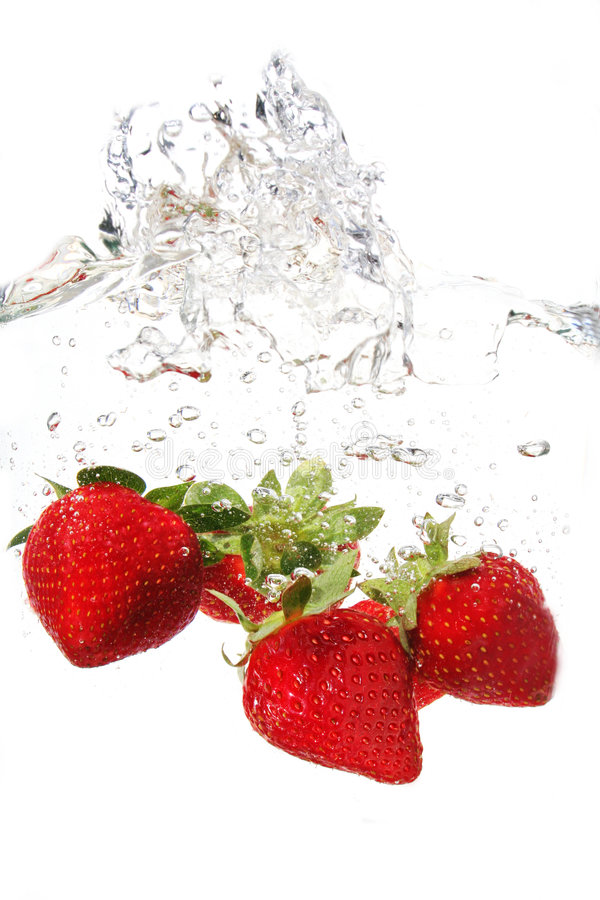 Strawberries in water. Water drops and strawberries in water stock photos