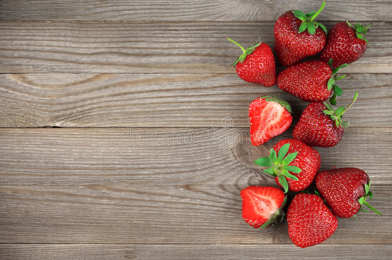 Strawberries on weathered wood stock image