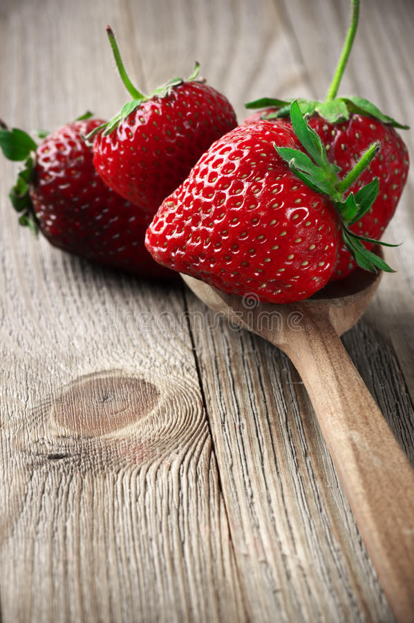 Strawberries on weathered wood royalty free stock photography