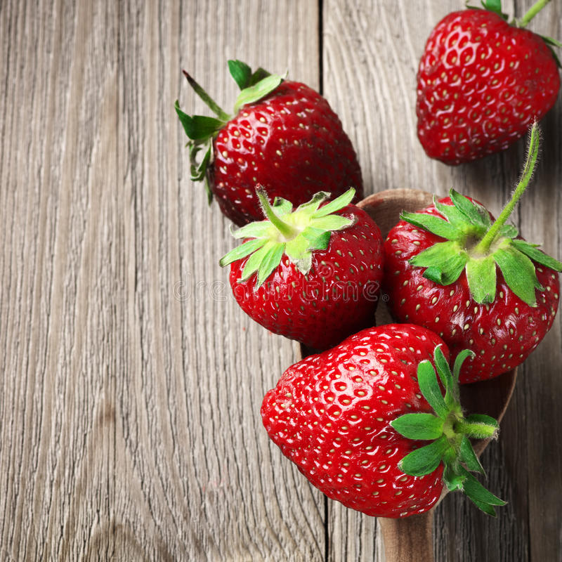 Strawberries on weathered wood royalty free stock photos