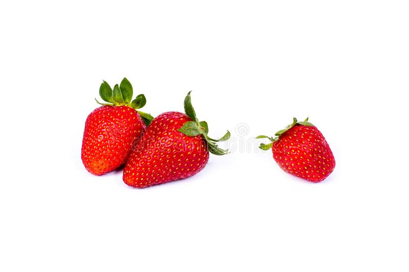 Strawberries on a white background. Group of red strawberries on a white background. Fresh and juicy strawberries on an isolated b stock photos
