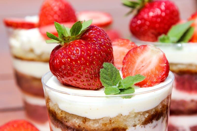 Strawberries on white cream of cake. Strawberries on white cream of cake royalty free stock photos