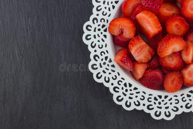 Strawberries on a white plate stock image